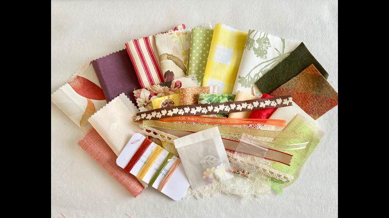 A range of Autumnal coloured fabrics and trims
