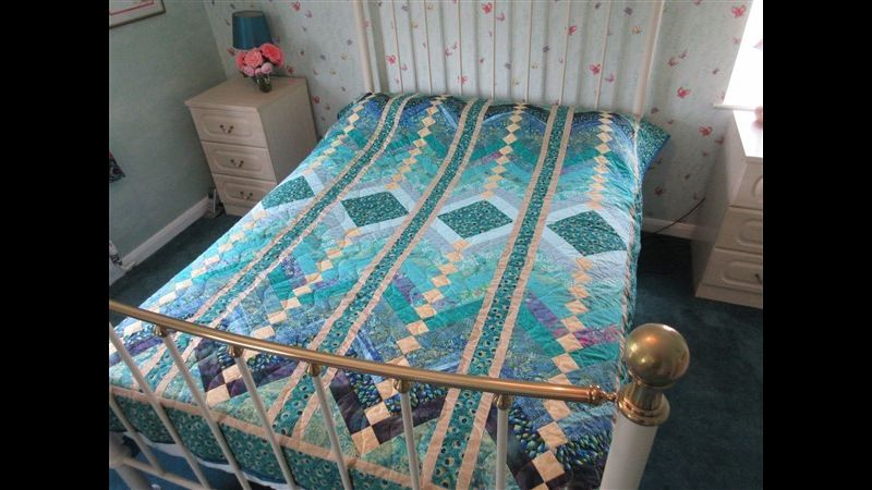 Stunning double bed quilt in peacock colours