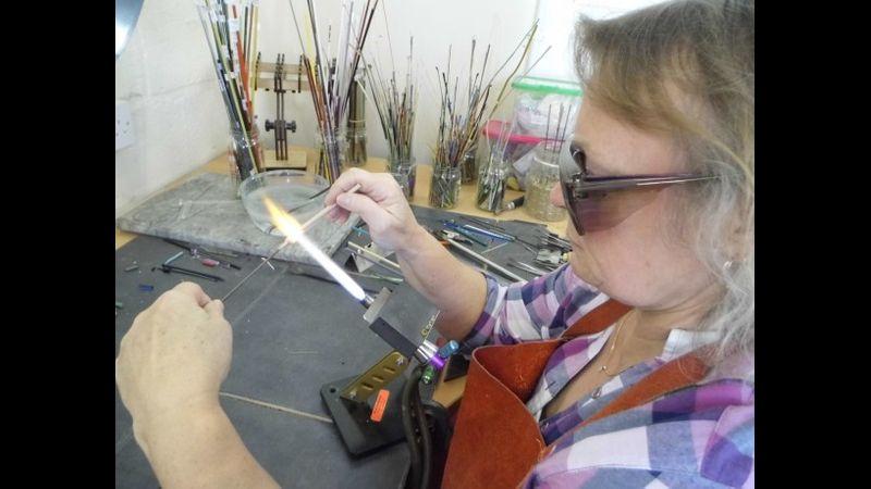 Student making beads