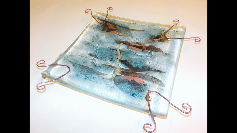 Fused glass with metal inclusions