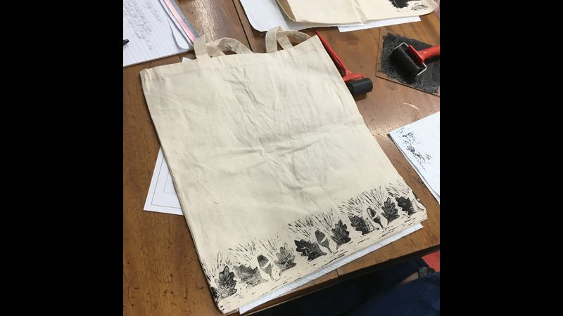 A students tote bag they printed onto with a lino block they created
