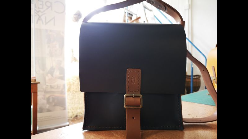 student's leather messenger bag