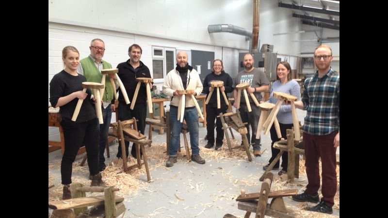 Happy stool makers at the end of a course