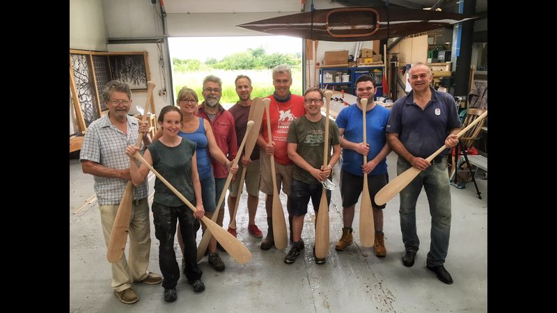 A very happy bunch of paddle makers!