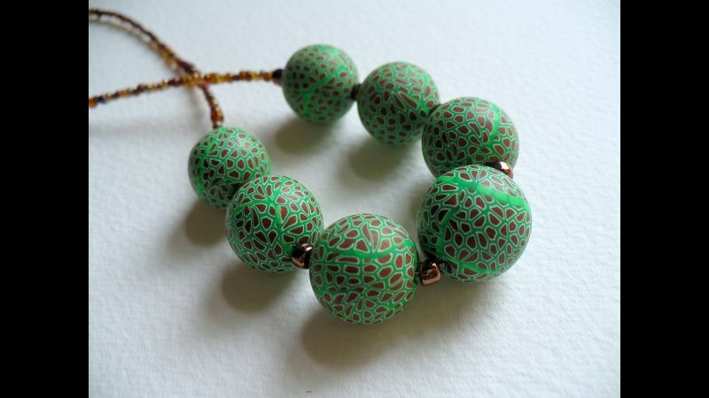 Chunky green and gold beads made on the Polymer Clay Millefiori style Bead workshop, West Country Creative, on the Devon/Cornwall border