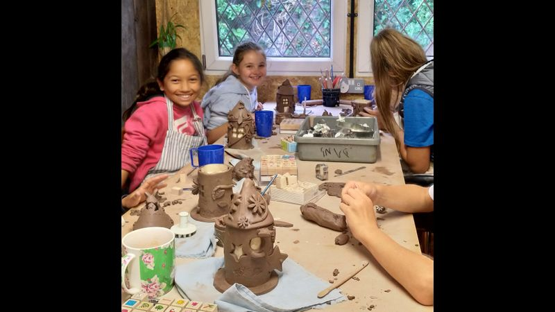 Making fairy house with clay
