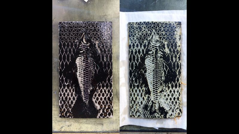etched lino print next to its printing plate