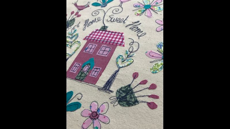 Machine embroidered house