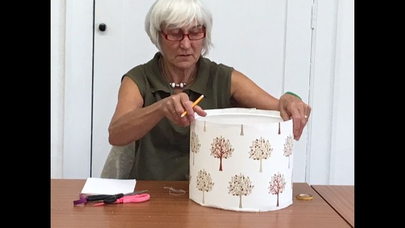 Student rolling the lampshade edge