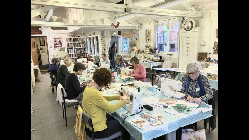 Students busy sewing at the Free-machine embroidery workshop with Dawn in her Sheffield studio.