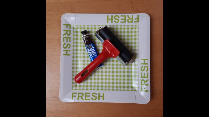 A paper print tray, printing ink and a brayer.