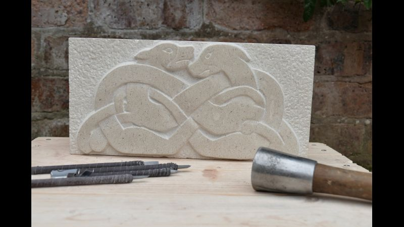celtic knotwork dragons stone carving