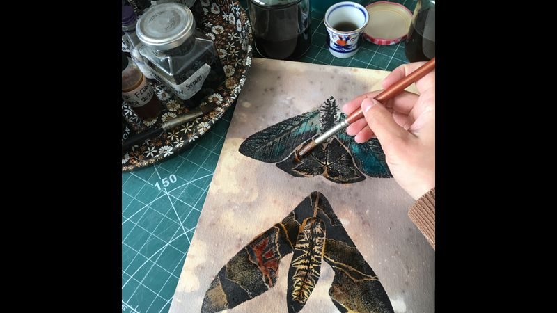 Printing plate with two moth designs being prepared