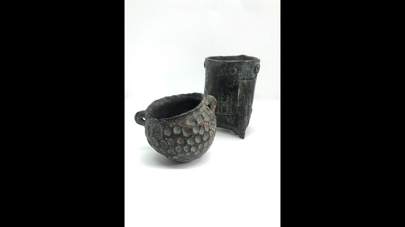 Two pit fired ceramic vessels