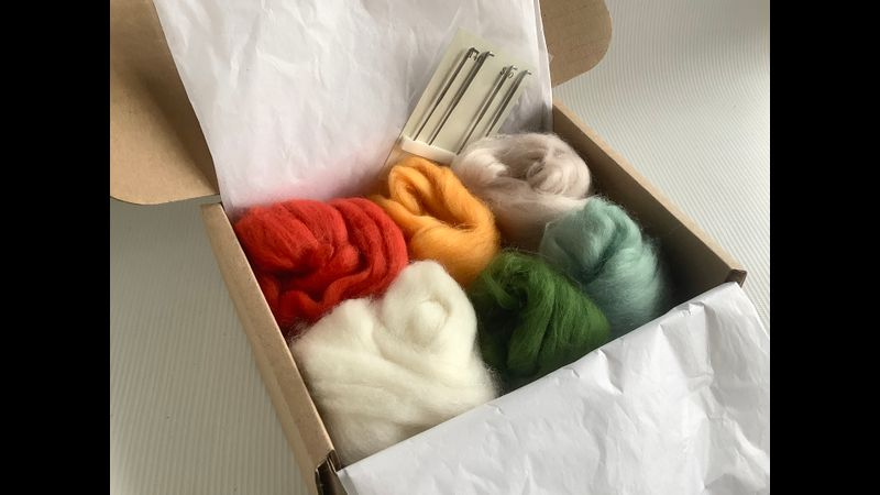 A generous amount of wools so that you can make more little toadstools when the workshop is over and four felting needles on a card holder.