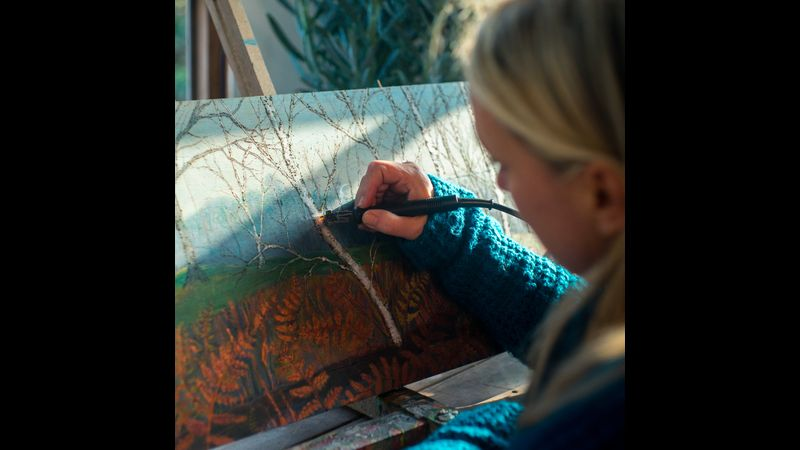 Ruth working on an Autumn Woodland scene ( pyro and paint technique)