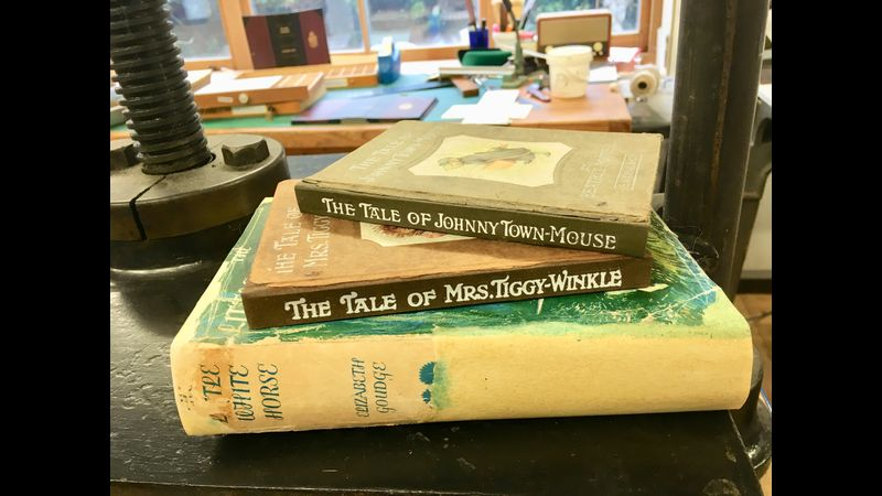 Two Beatrix Potter Books reapaired and a dust jacket repaired too.