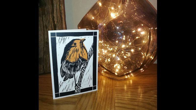 golden robin with christmas lights