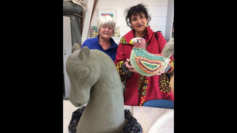 Jackie and Lucina making sculptures for mosaic.