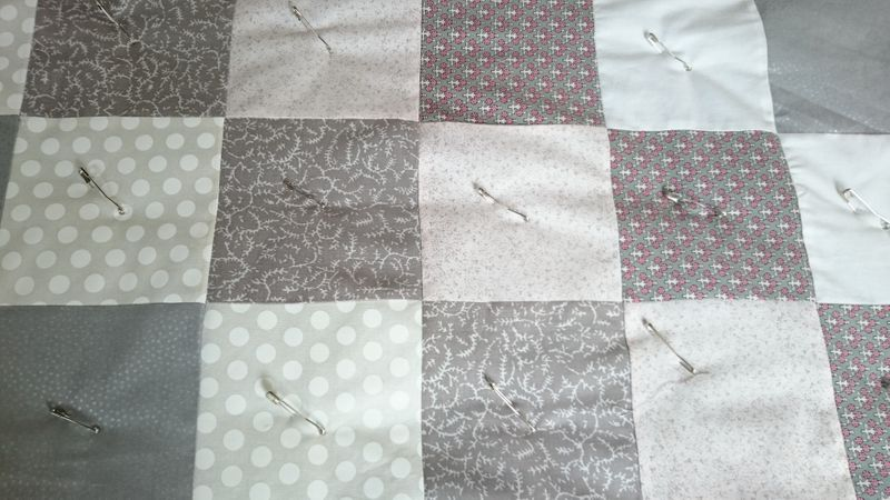 Using quilter's pins to hold the quilt layers