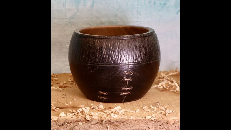 Magnolia pot, scorched and textured with copper wire stitching.
