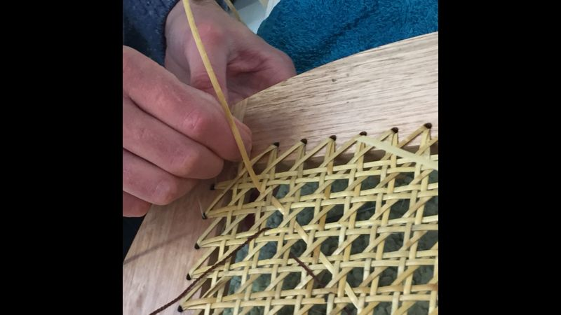 Beginning step 6 of the cane weaving pattern.
