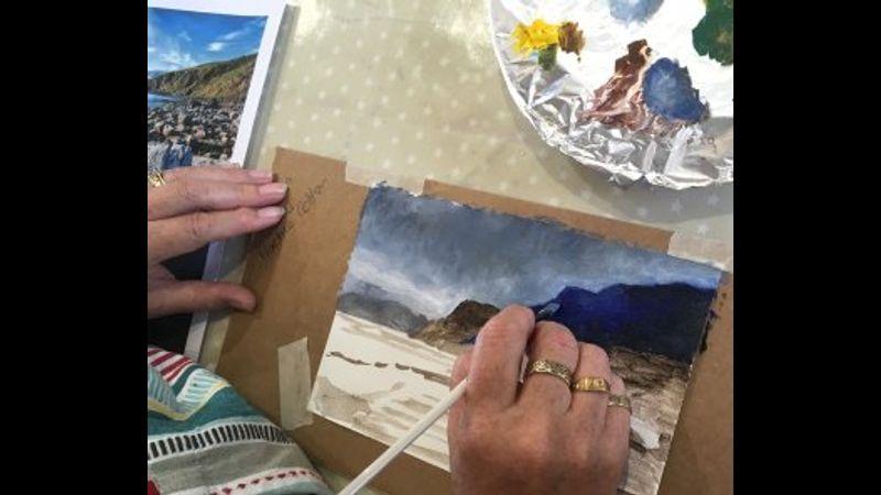 Landscape oil painting in progress under Clare's watchful eye.